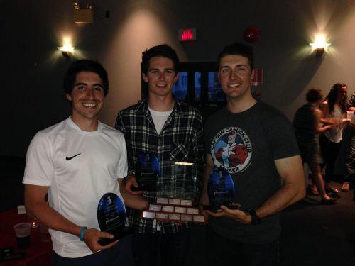 Alexander Limoges-Friend (Centre), crew member of Thunder Spirit with trophy.