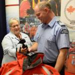 Sarnia-Lambton MP Pat Davidson speaks Wednesday with Jamie Kerwin, with the Canadian Coast Guard Auxiliary, about some of the equipment its volunteers use, following an event held in Sarnia to promote the contributions made by the auxiliary. (PAUL MORDEN, The Observer)