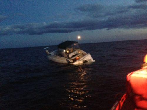 Approaching the sinking vessel