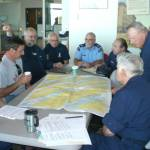 Boyd and Jim with John Gonzolas and team reviewing chart assignment